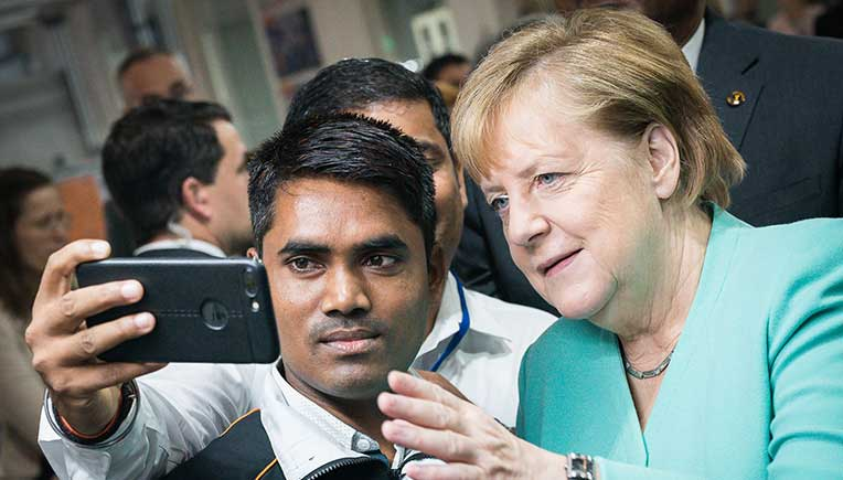 Selfies, discussions for German Chancellor Dr. Angela Merkel at Continental office