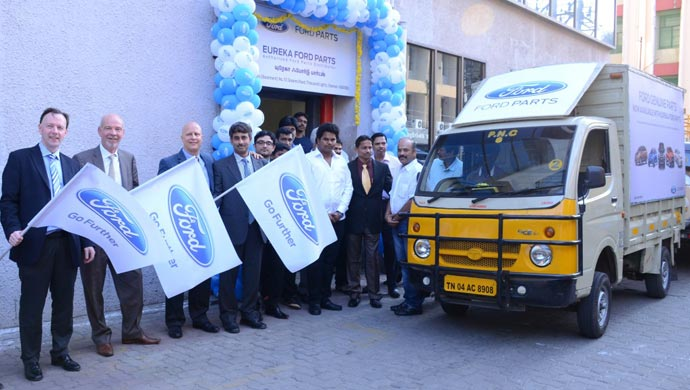Ford officials flagging off the components