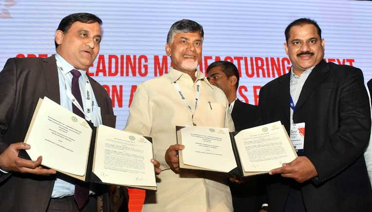 J Krishna Kishore, CEO, AP Economic Development Board, AP Chief Minister N Chandrababu Naidu and Shekhar Movva, President, Synergies Castings Limited exchanging the MoU.