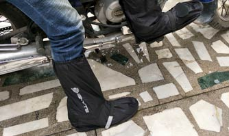 Ignyte shoe cover for riding two wheelers during rainy days