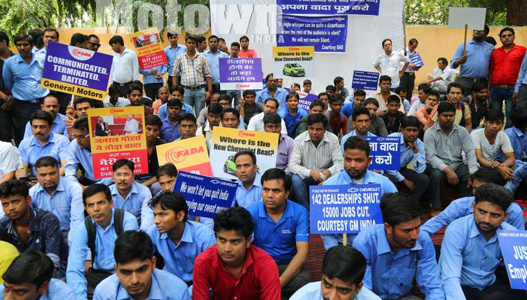 GM exit, a planned scam, say protesting GM India dealers