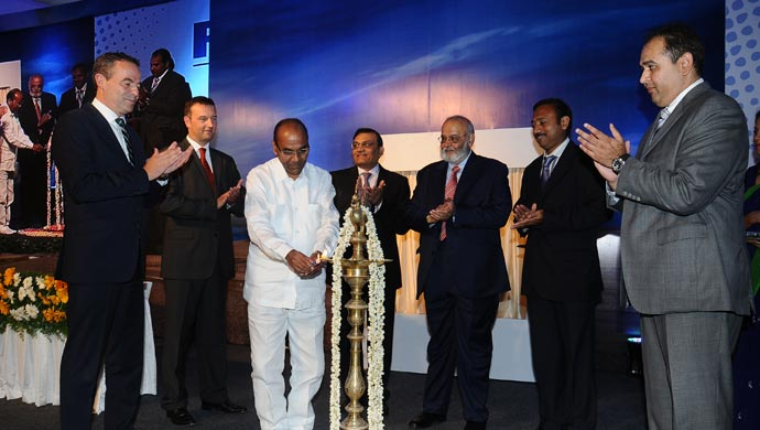 Anant Geete, Union Cabinet Minister for Heavy Industries and Public Sector Enterprises, and dignitaries lighting the lamp