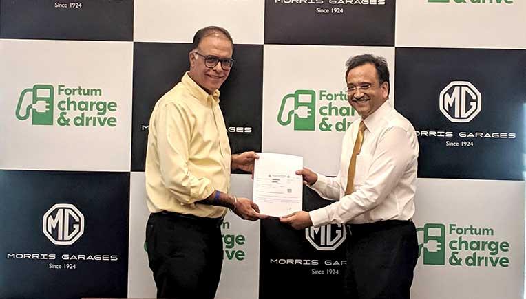 Rajeev Chaba, President & Managing Director, MG Motor India and Sanjay Aggarwal, Managing Director, Fortum India