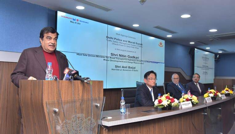 Nitin Gadkari addressing media at the signing of the MoA between the Delhi Police & Maruti Suzuki. Also present at the occasion were, L-R_ Kenichi Ayukawa, MD & CEO, Maruti Suzuki and others