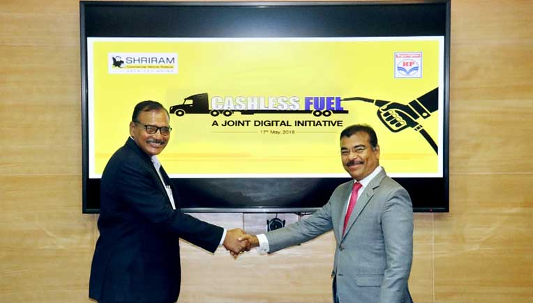 R To L-Umesh Revankar, MD & CEO, STFC and G S V Prasad, Executive Director-Retail, HPCL