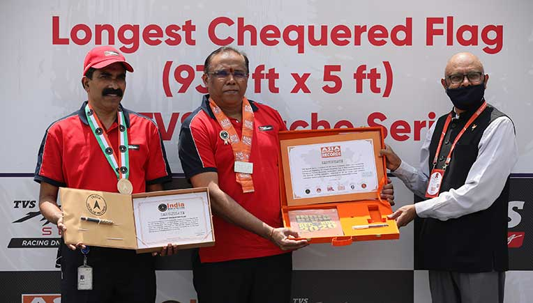 """To commemorate the 4 million global sales milestone celebrations, TVS Motor Company, in collaboration with its TVS Apache customers has created the """"Longest Chequered Flag"""""""