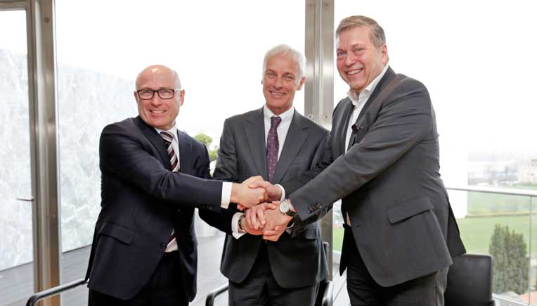 From L to R: Bernhard Maier, CEO of Skoda Auto, Matthias Muller, CEO of Volkswagen AG and Gunter Butschek, CEO & Managing Director of Tata Motors Ltd.