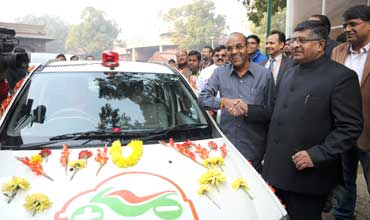 GREEN DAY: Geete takes his new Mahindra electric car to Parliament