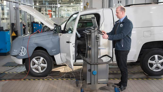 Inspecting a vehicle at the VW plant; Pic for representation purpose only