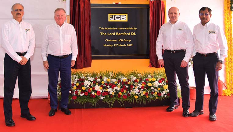JCB officials while making announcement on investments