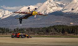Red Bull Racing Honda F1 goes head to head with inverted plane