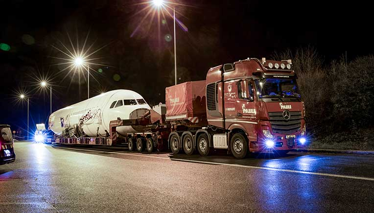 A flight by road on a Mercedes-Benz truck