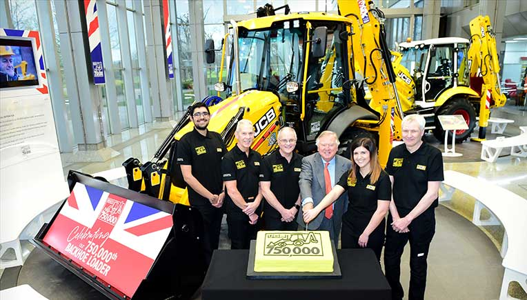 {L-R} JCB backhoe loader employees Nihal Dhillon, Phil Starbuck, John Plant, JCB Chairman Lord Bamford, Shannon Ramczykowski and Keith Bloor