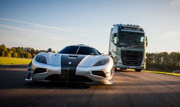 Volvo truck races against a Koenigsegg sports car