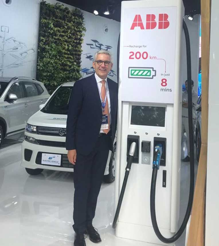 Ulrich Spiesshofer, Chief Executive Officer of ABB with ABB fast-charger at the MOVE Global Mobility Summit 2018